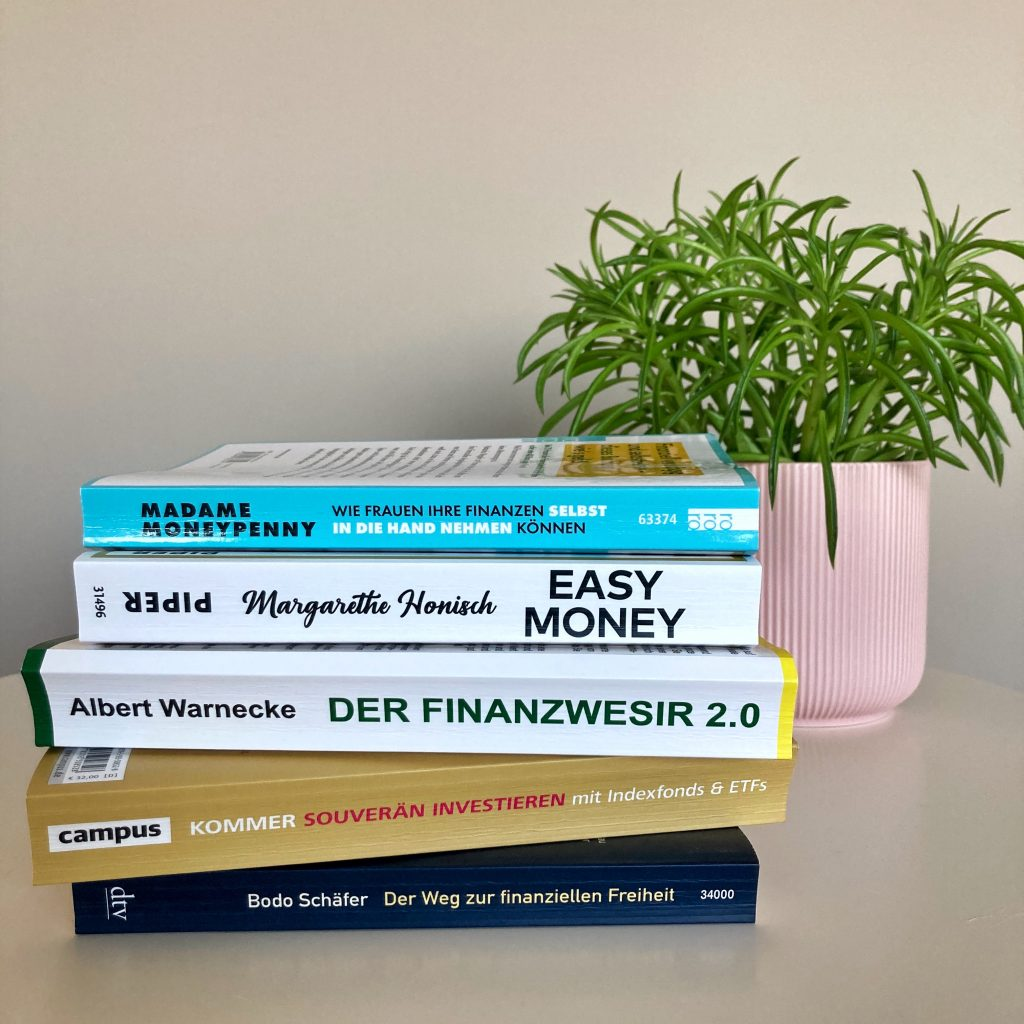 the best books on personal finance in german stacked upon each other