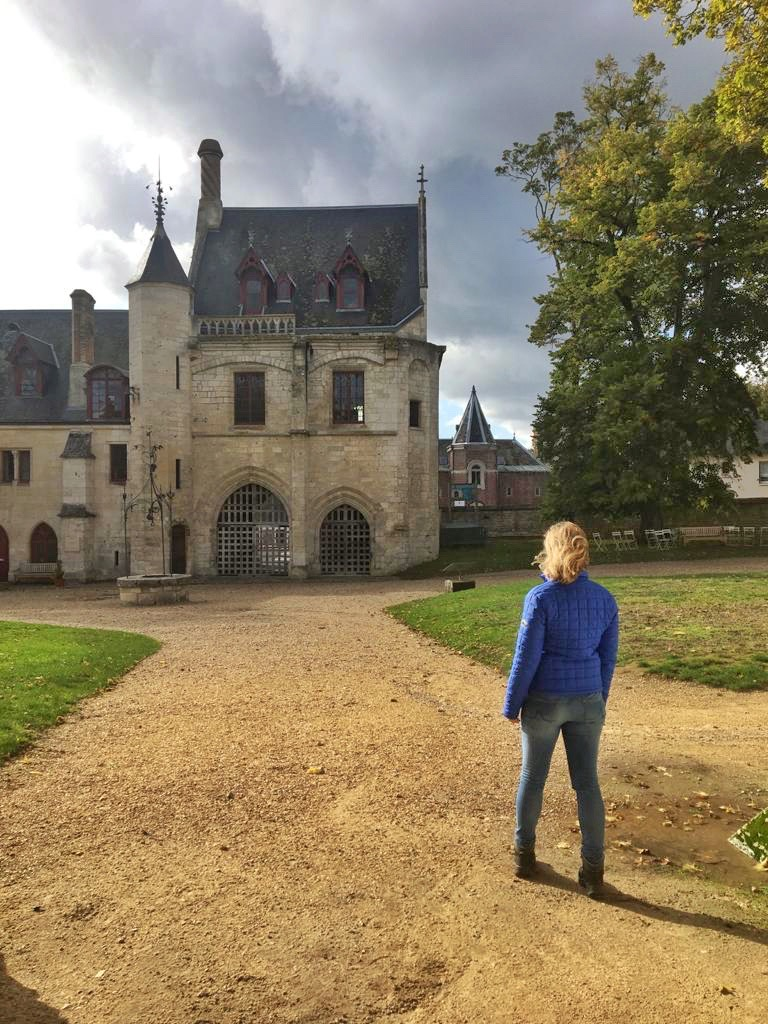 picture of the author of the nonfiction book recommendatitons on this book blog for change in front of a gothic castle