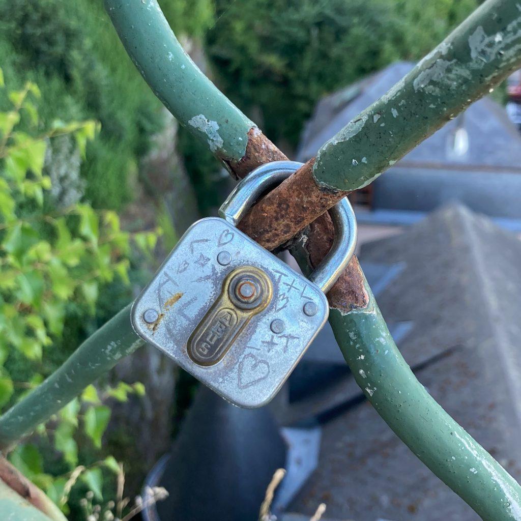 a padlock on a fence